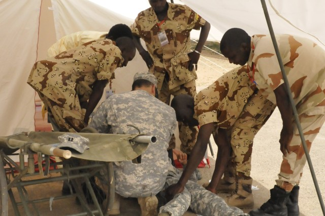 U.S. Army reserve combat medics, assigned to the 407th Ambulance Company, work with Chadian Army combat medics on Tactical Combat Casualty Care during MEDRETE 14-5 at the Hospital Military D' Instruction (HMI) in N'Djamena, Chad, June 2-12, 2014.
