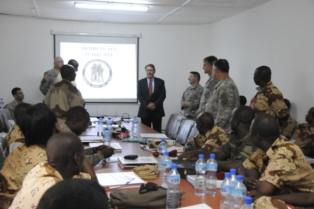Eric P. Whitaker, deputy chief of mission for the U.S. embassy in N'Djamena, Chad, talks to U.S. and Chad medical professionals during MEDRETE 14-5 at the Hospital Military D' Instruction (HMI) in N'Djamena, Chad, June 2-12, 2014.