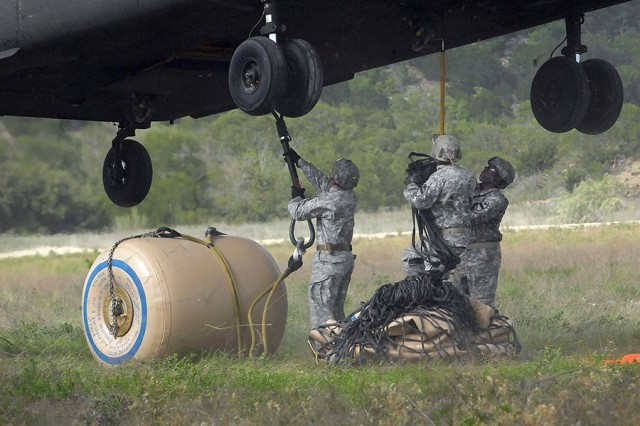 Soldiers from A Company, 115th Brigade Support Battalion, prepare to sling load a water blivet using a CH-47 Chinook helicopter.