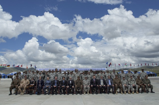 Distinguished guests and leaders from participating nations pose for a group photo during the opening ceremony of Khaan Quest 2014, or KQ14, at Five Hills Training Area, Mongolia, June 20, 2014. KQ14 is a regularly scheduled, multinational exercise co-sponsored by U.S. Army Pacific, and hosted annually by Mongolian Armed Forces. KQ14 is the latest in a continuing series of exercises designed to promote regional peace and security.