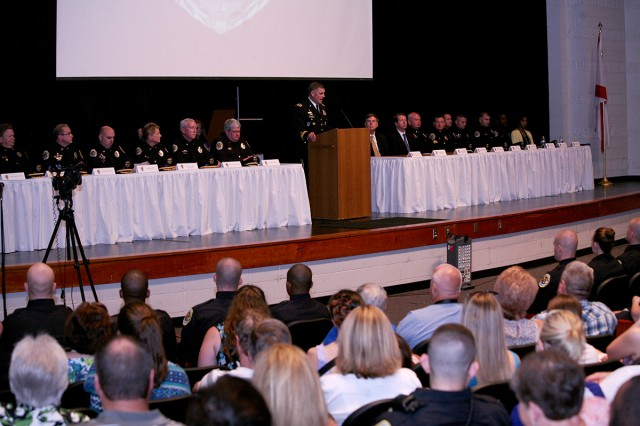 Lt. Gen. David L. Mann, commanding general, U.S. Army Space and Missile Defense Command/Army Forces Strategic Command, speaks to the graduating class of the Huntsville Police Academy's 53rd Session and guests at Columbia High School June 20.