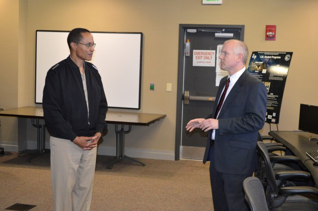 Navy Adm. Cecil Haney, commander of U.S. Strategic Command, receives a briefing about the U.S. Army Space and Missile Defense Command/Army Forces Strategic Command Concepts Analysis Laboratory by Kevin Nash, CAL supervisor, and how the command uses the CAL to train college students and future engineers. Haney visited USASMDC/ARSTRAT's Redstone Arsenal, Ala., headquarters June 20.