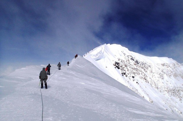 The 4th Infantry Brigade Combat Team (Airborne), 25th Infantry Division, climb team, sponsored by U.S. Army Alaska, makes its way across Summit Ridge on Mount McKinley, June 15, 2014, at the Denali National Park and Preserve, Alaska. The team was there to demonstrate their arctic abilities and validate both their training and their equipment.