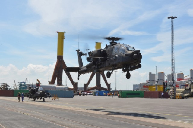 An AH-64D Apache from the 12th Combat Aviation Brigade prepares to land June 12 at the port of Bremerhaven, Germany.