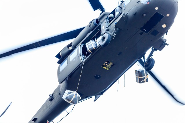 Enhanced Speed Bags are dropped from a helicopter during the Army Expeditionary Warrior Experiment Speed Bag Operation January 28, 2014, at Fort Benning, Ga.