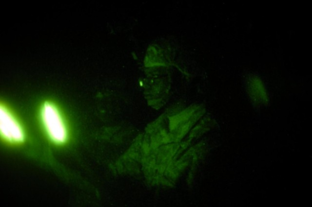 Spc. Zachary Powe, a water treatment specialist with Company A, 703rd Brigade Support Battalion, 4th Infantry Brigade Combat Team, 3rd Infantry Division, demonstrates the proper technique for ground guiding vehicles during blackout conditions on Fort Stewart, Ga., June 20, 2014. Ground guiding techniques were taught during night driver's training to ensure the safety and proficiency of the soldiers when conducting night operations.