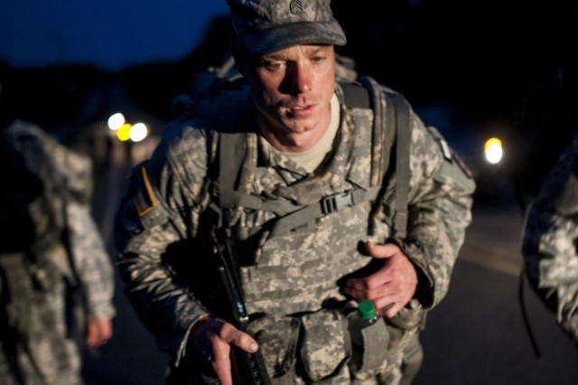 Staff Sgt. James Thornton, a combat engineer with the 323rd Engineer Company, resident of Spartanburg, S.C., endures an early morning road march that spanned eight miles while carrying a 35-pound ruck and a rifle during the 2014 Army Reserve Best Warrior Competition at Joint Base McGuire-Dix-Lakehurst, N.J., June 25. (U.S. Army photo by Sgt. 1st Class Michel Sauret)
