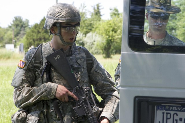 Pfc. Matthew Creavey, from Dillsburg, Pa., a Chaplains Assistant with the 1185th Deployment and Distribution Support Battalion out of Lancaster Pennsylvania, searches a vehicle during the 2014 Army Reserve Command Best Warrior Competition, June 24. (U.S  Army photo by Sgt. Francesca Stanchi).