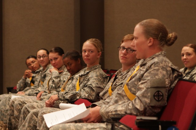 A Soldier asks a question during a leadership forum June 18 in Kerwin Auditorium about career opportunities in the Army and the changing climate of women serving in new roles. The small group of field artillery Soldiers asked a panel of women leaders for advice and listened to their experiences.