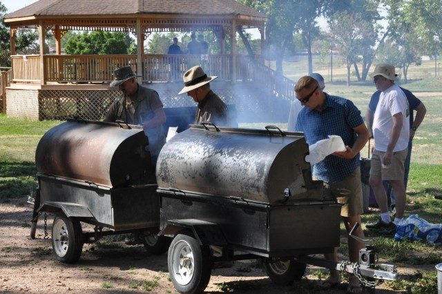 U.S. Army Space and Missile Defense Command/Army Forces Strategic Command volunteers grill food for Organization Day participants June 20 at Iron Horse Park.