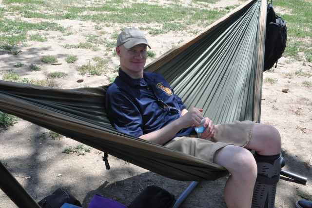 Sgt. 1st Class Jeremy Emrick, 1st Space Brigade, U.S. Army Space and Missile Defense Command/Army Forces Strategic Command, relaxes during Organization Day June 20 at Iron Horse Park.
