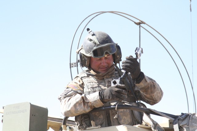 Staff Sgt. David Randolph, 2nd Battalion, 4th Field Artillery, prepares to depart on a fire mission during a three-week field artillery exercise June 21 at Dona Ana Range complex in New Mexico.