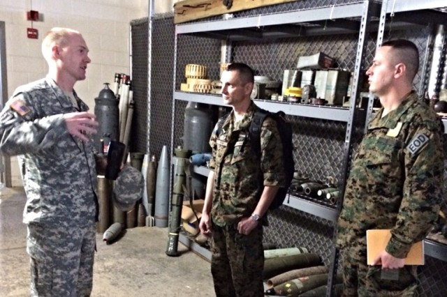 Capt. David Watkins (left), commander of the 55th Explosive Ordnance Disposal Company, talks with Bosnian Army Capt. Aleksandar Atelj (center) and Staff Sgt. Arnes Hodzic, during their visit to the United States.