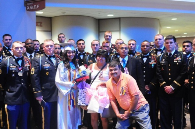 Lluvia Loeza's mother, father, and older brother, Esteban, gather with 1-41 Infantry Battalion Soldiers and friends after the graduation ceremony. Staff Sgt. Roberto Loeza, Jr., was killed in action during the unit's previous deployment to Afghanistan. The Soldiers stood in for Loeza, since he could not be present.  (U.S. Army Photo by 3-1 AD Public Affairs Office, 3rd Brigade Combat Team, 1st Armored Division/Released)