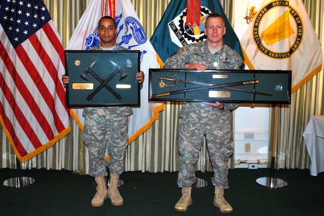 "Pfc. Davonta T. Colflesh (left) and Staff Sgt. Kevin A. Hopson display their ""Best Warrior"" awards from the U.S. Army Sustainment Command at an awards breakfast held at the Rock Island Arsenal Golf Club June 26. Colflesh was selected as ASC's 2014 Soldier of the Year and Hopson as ASC's 2014 NCO of the Year. (Photo by Dawn Marie Barnett, ASC Public Affairs)"