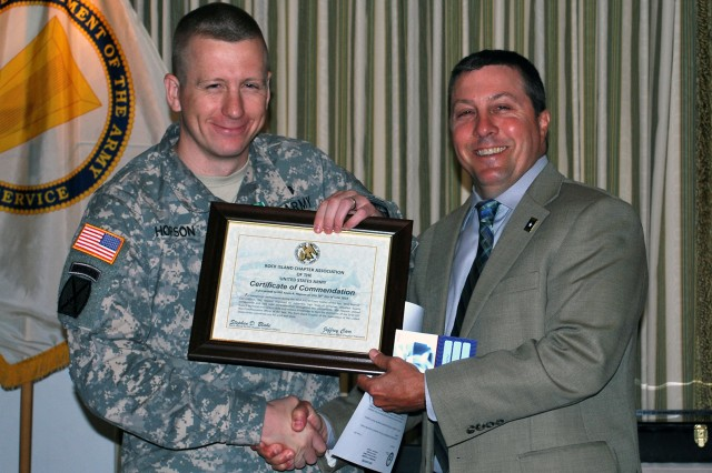 Staff Sgt. Kevin A. Hopson, force protection NCO of U.S. Army Sustainment Command Headquarters, Rock Island Arsenal, Ill., receives a Certificate of Commendation from Jeff Carr, president of the local AUSA, during the ASC Best Warrior award breakfast on June 26. (Photo by Dawn Marie Barnett, ASC Public Affairs)
