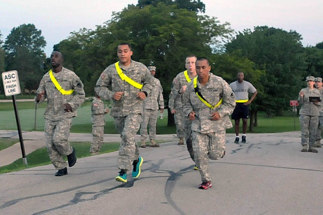 Soldiers begin the 2-mile run as part of the Army Physical Fitness Test early June 24 near the shoreline of the Mississippi River. Finishing first was Pfc. Davonta T. Colflesh (center in blue shoes), 403rd Army Field Support Brigade, Daegu, Korea. (Photo by Jon Micheal Connor, ASC Public Affairs)