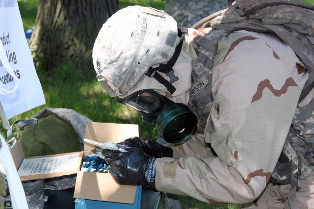 Staff Sgt.  Kevin A. Hopson, Force Protection NCO, ASC headquarters, reads directions for the air quality test during the Chemical, Biological, Radiological and Nuclear portion of the ASC Best Warrior Competition. (Photo by Kimberly Conrad, JMTC Public Affairs)