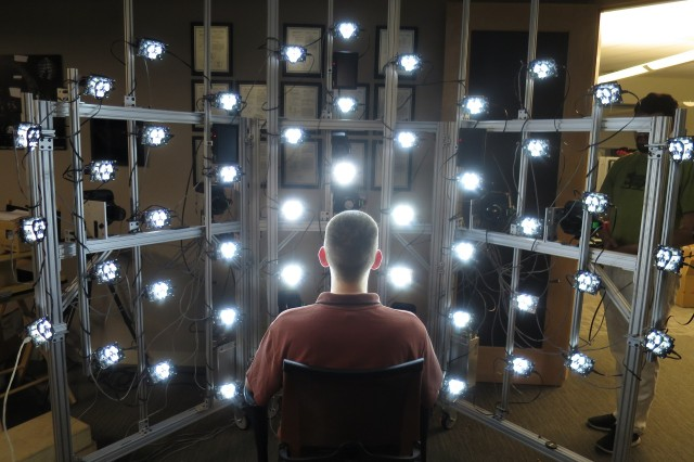 Shown here Maj. Paul Graham, with the U.S. Air Force, helps test the mobile light stage used for scanning President Barack Obama. Maj. Graham helped develop the system as part of his recently completed Ph.D. in Computer Science at USC with the ICT Graphics Lab.