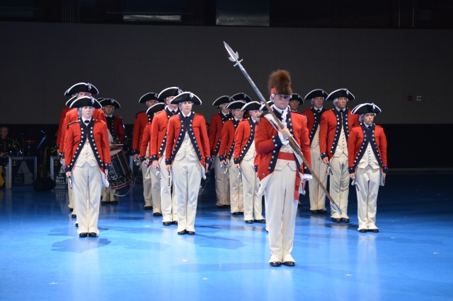 "Soldiers from the 3rd U.S. Infantry Regiment (The Old Guard), and the U.S. Army Band ""Pershing's Own,"" perform during Twilight Tattoo held at Joint Base Myer-Henderson Hall, Va., June 25, 2014."
