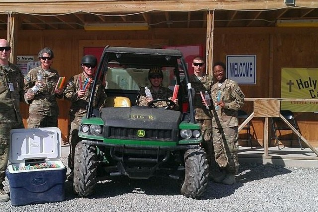 Chaplain (Capt.) Andrea Baker (2nd from left) delivers ice cream with the brigade unit ministry team in Afghanistan.