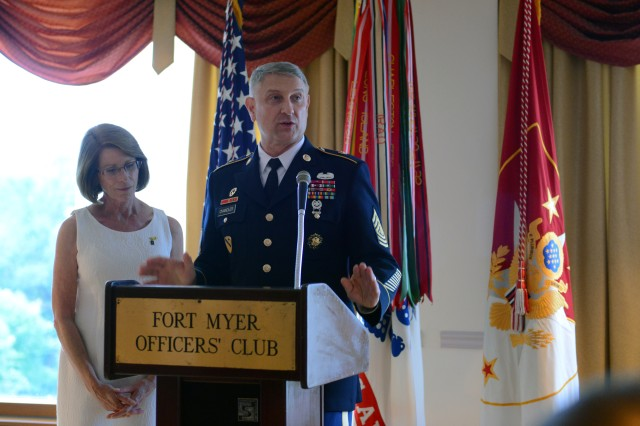 Sgt. Maj. of the Army Raymond F. Chandler III, with his wife Jeanne Chandler, greets distinguished guests and talks about the importance of non-commissioned officers, at a reception before a Twilight Tattoo he hosted that honored NCOs, at Joint Base Myer-Henderson Hall, Va., June 25, 2014.