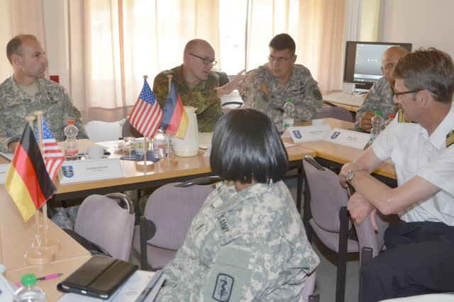 Col. Dr. Rolf von Ulsar (center), chief of the Bundeswehr Medical Service Headquarters Concept Development, Research and International Cooperation branch, discusses partnering opportunities with Army Medicine in Europe members during a meeting in Koblenz June 26.