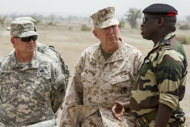 U.S. Army Africa Deputy Command General Brig. Gen. Kenneth Moore (left) Lt. Gen. Steven A. Hummer (center) and Brig. Gen. Cheikh Gueye (right) discuss their observations of the cordon and search situational training exercise during Exercise Western Accord 14, June 26. Exercise Western Accord 14 is a U.S. Army Africa-hosted annual joint training and partnership exercise between the United States and Economic Community of West Africa States, which is designed to increase interoperability between military forces and ensure the common ability to conduct peace operations throughout Western Africa.