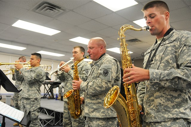 Sgt. Logan Mills and other members of Sabor Tropical practice June 19 to prepare for their performance during Freedom Fest.
