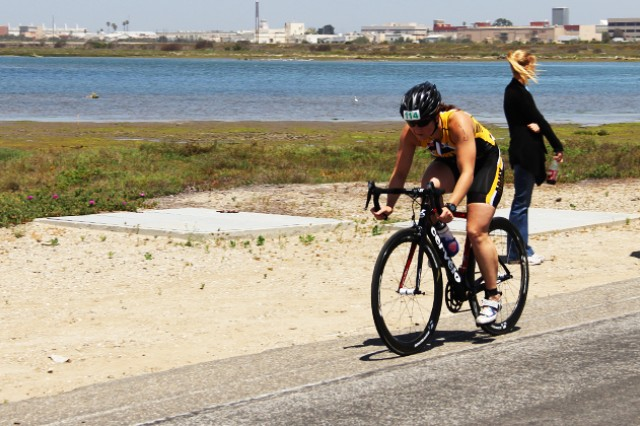 Second Lt. Justine Emge races on her bike May 31, 2014, during the Armed Forces Triathlon Championship at Naval Base Ventura County, Point Mugu, Calif.