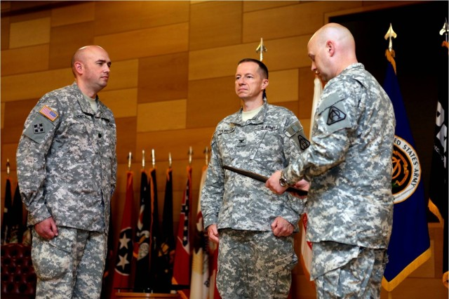 Left to right: Lt. Col. Thomas Bentzel, outgoing product manager for Tactical Mission Command (TMC), Col. Michael Thurston, Project Manager for Mission Command and Lt. Col. Shane Taylor, incoming product manager for TMC complete the TMC Change of Charter.