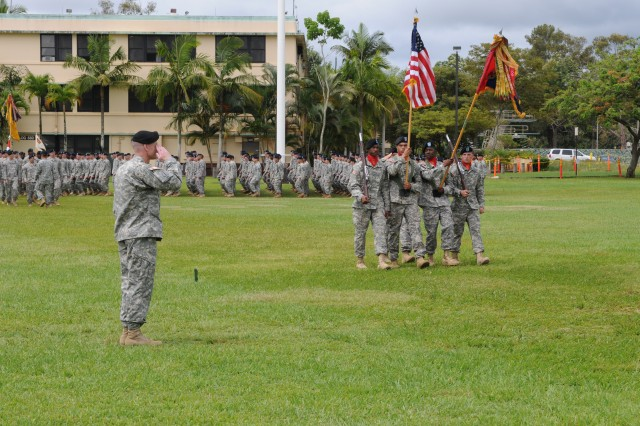 Col. Scott W. Kelly, commander, 3rd Brigade Combat Team, 25th Infantry Division, salutes the U.S. Flag as the brigade color guard passes the reveiwing stand durin the pass and reveiw portion of his change of command ceremony at Weyand Field, Schofield Barracks, on June 27, 2014.