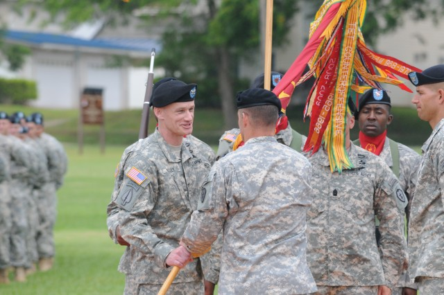 Col. Scott W. Kelly, incoming commander, 2rd Brigade Combat Team, 25th Infantry Division, receives the brigade colors from Maj. Gen. Charles A. Flynn, commander, 25th Infantry Division, during a change of command ceremony at Weyand Field, Schofield Barracks, June 27, 2014.