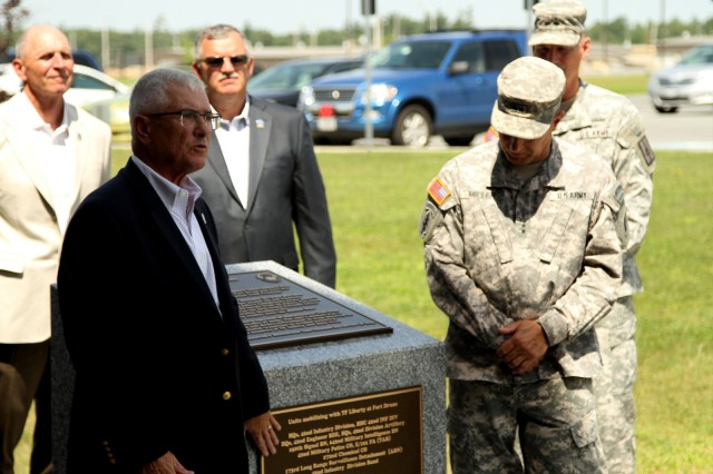 "Retired New York Army National Guard Maj. Gen. Joseph Taluto, former commander of the 42nd Infantry Division, during its service in Iraq, in 2005, dedicates the memorial to the division's citizen-Soldiers with current commander, Maj. Gen. Harry Miller.  The Army National Guard's ""Rainbow Division"" commemorated the 10th Anniversary of the unit's mobilization for combat service in Iraq, June 28, 2014."