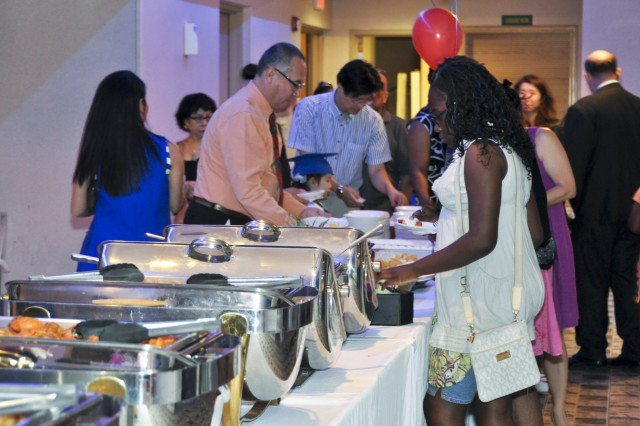 The attendees of the event are getting the provided meals during the Pre-Kindergarten Graduation event, Jun 13. (U.S. Army photo by Cpl. Jung Young Ho)