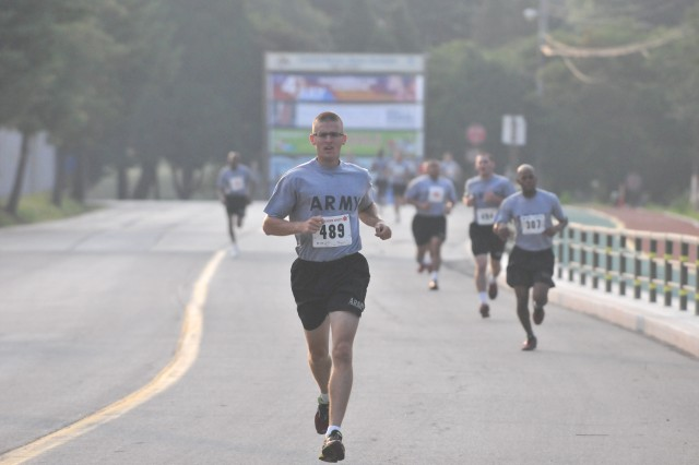 CAMP CASEY, South Korea -- Soldiers from 2nd Infantry Division participate in a division fun run and a 5 kilometer run June 30, 2014 at Indian Head Field on Camp Casey, South Korea. The three-mile run was led by Maj. Gen. Thomas Vandal and Command Sgt. Maj. Andrew Spano, the command team for 2nd Inf. Div., and marks the beginning of this year's Warrior Friendship Week celebration, a week of sporting events and friendly competition to build unit cohesion and strengthen the alliance between the Republic of Korea and the United States.