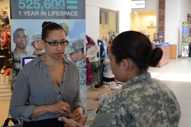 Sgt. Yesenia Albiter, right, a Force Health noncommissioned officer assigned to Katterbach Army Health Clinic, talks health issues with Stacy Drones, left, a contractor who had just had her blood pressure checked during the Army Performance Triad kickoff inside The Exchange at Urlas June 4, 2014.