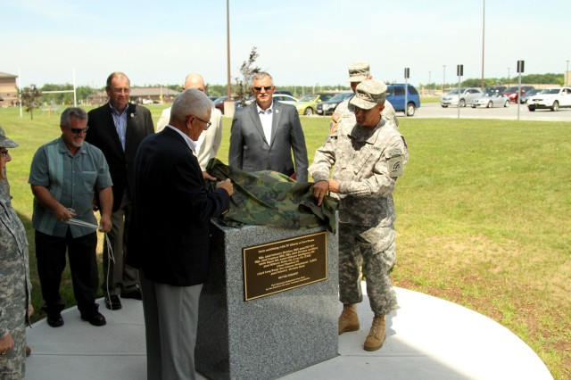 FORT DRUM, N.Y. - Retired Maj. Gen. Joseph Taluto, left, former commander of the 42nd Infantry Division and Adjutant General of the State of New York, representing the Rainbow Division Veterans Foundation, joins current Rainbow Division Commander Maj. Gen. Harry Miller unveiling a memorial that commemorates the 10th anniversary of the mobilization of the 42nd Infantry Division for combat service in Iraq. The division mobilized in 2004 to form the division base of Task Force Liberty, a force that would see more than 23,000 Soldiers serve in North Central Iraq. Photo by Master Sgt. Peter Towse, 42nd Infantry Division.