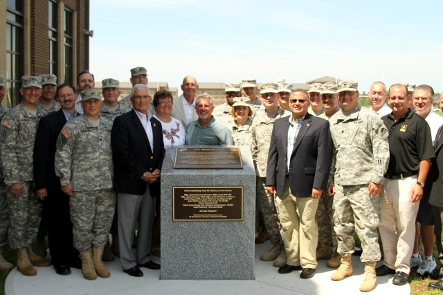 FORT DRUM-- Serving and retired New York Army National Guard Officers and NCOs who deployed to Iraq as part of the headquarters of the 42nd Infantry Division in 2005 gather around a newly dedicated memorial marking their service on June 28 during a short ceremony here. The plaque, and one like it at Fort Dix, New Jersey which will be dedicated in September, were provided by the Rainbow Division Veterans Foundation.