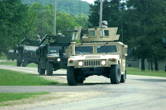 Soldiers with the 79th Military Police Company from Wabasha, Minn., start off on a convoy as part of operations for the Guardian Warrior exercise at Fort McCoy's Forward Operating Base Liberty.