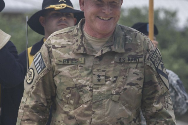 Maj. Gen. Michael Bills, commander, 1st Cavalry Division, added his second star during his promotion on Cooper Field at Fort Hood, Texas, June 27. Bills took command of the 1st Cav. Div. in March and has since deployed along with roughly 300 Soldiers assigned to the division headquarters. The division will serve as the Regional Command-South headquarters in Afghanistan. (U.S. Army photo by Sgt. Angel Turner, 1st Cav. Div. PAO) (Released)