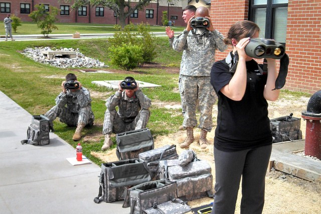 Soldiers from 4th Brigade Combat Team, 82nd Airborne Division operate the Mark VIIE LTLM at Fort Benning, Georgia, in September 2013 while conducting PdM SPTD's Advanced Targeting and System Integration class. At right is Raschelle Barkume, a graduate research assistant from OSU who attended the class to gather data on current operating models and doctrinal employment of the systems.
