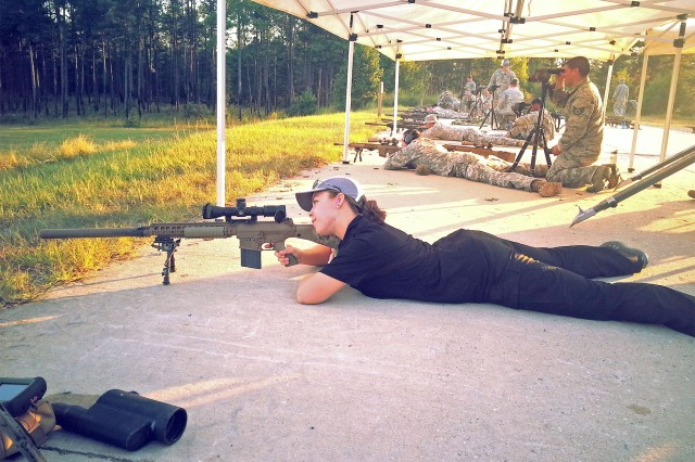 Barkume engages targets with the M110 Semi-Automatic Sniper System while training at the U.S. Army Sniper School, Fort Benning. Her purpose was to gather data on user requirements, in conjunction with the Maneuver Center of Excellence, while demonstrating prototype products.
