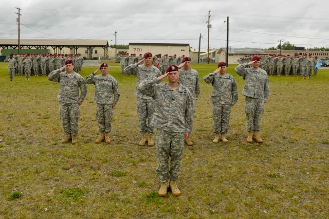 Infantry Brigade Combat Team (Airborne), 25th Infantry Division, along with incoming and outgoing commanders from the battalion's Hammer, Sapper and Hydra Companies and their paratroopers stand at attention and salute as the national anthem is played during a triple change of command ceremony June 26, 2014 at Joint Base Elmendorf-Richardson, Alaska. (U.S. Army photo by Sgt. 1st Class Jeffrey Smith/Released)