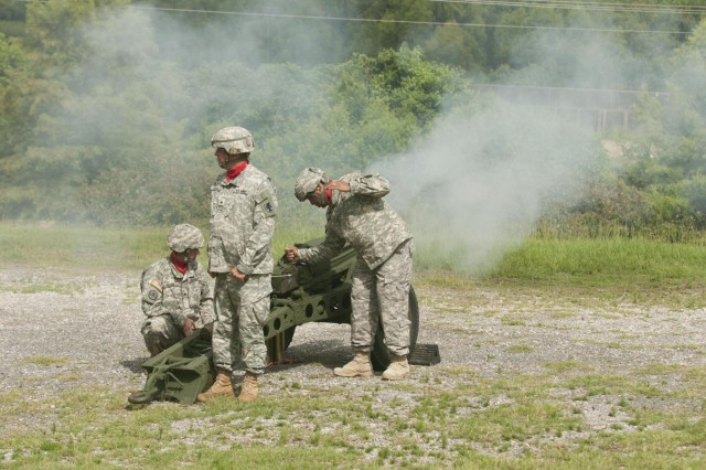 U.S. Army Reserve Soldiers of the 412th Theater Engineer Command fire 75mm Howitzers for ceremonial presentation of the shell casings during a change of command ceremony at the Vicksburg Convention Center in Vicksburg, Miss., June 29. Maj. Gen. William M. Buckler Jr. relinquished command to Brig. Gen. Tracy A. Thompson. (U.S. Army photo by Sgt. Devin Wood)