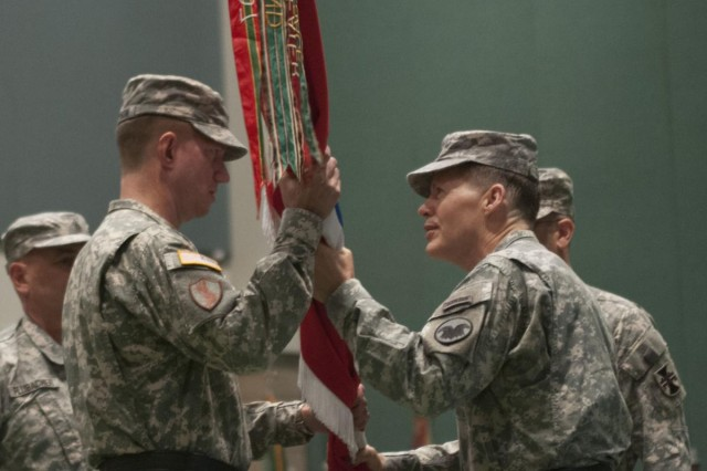 Brig. Gen. Tracy A. Thompson (left), accepts the 412th Theater Engineer Command's unit colors from Lt. Gen. Jeffrey W. Talley, the chief of Army Reserve and commanding general of the U.S. Army Reserve, symbolizing his assumption of command during the 412th change of command ceremony at the Vicksburg Convention Center in Vicksburg, Miss., June 29. The 412th TEC conducted a change of command for incoming commander Thompson and outgoing commmander Maj. Gen. William M. Buckler Jr., a retirement ceremony for Buckler and a ceremonial promotion ceremony for Thompson at the Vicksburg Convention Center in Vicksburg, Miss., June 29. (U.S. Army photo by Staff Sgt. Roger Ashley)