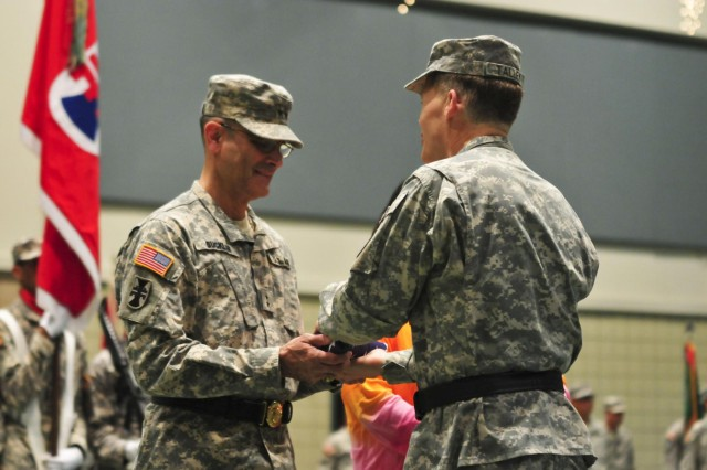 Lt. Gen. Jeffrey W. Talley (right), the chief of Army Reserve and commanding general of the U.S. Army Reserve, presents Maj. Gen. William M. Buckler Jr., with an American flag flown over the 412th Theater Engineer Command's headquarters June 27. The presentation took place during Buckler's retirement ceremony June 29 at the Vicksburg Convention Center in Vicksburg, Miss. The 412th TEC conducted a change of command for incoming commander, Brig. Gen. Tracy A. Thompson and outgoing commmander, Buckler, a retirement ceremony for Buckler and a ceremonial promotion ceremony for Thompson. (U.S. Army photo by Staff Sgt. Roger Ashley)