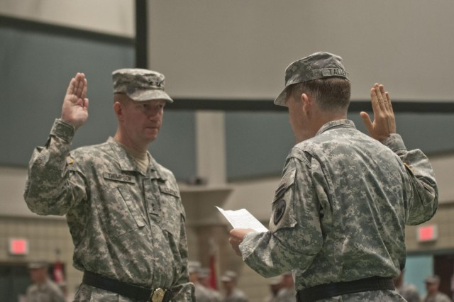 Lt. Gen. Jeffrey W. Talley (right), the chief of Army Reserve and commanding general of the U.S. Army Reserve, administers the oath of office to Brig. Gen. Tracy A. Thompson, 412th Theater Engineer Command commanding general following his ceremonial promotion to major general. Thompson will begin wearing his two stars on July 1 when his promotion orders take effect. The 412th TEC conducted a change of command for incoming commander Thompson and outgoing commmander Maj. Gen. William M. Buckler Jr., a retirement ceremony for Buckler and the promotion ceremony at the Vicksburg Convention Center in Vicksburg, Miss,, June 29. (U.S. Army photo by Staff Sgt. Roger Ashley)