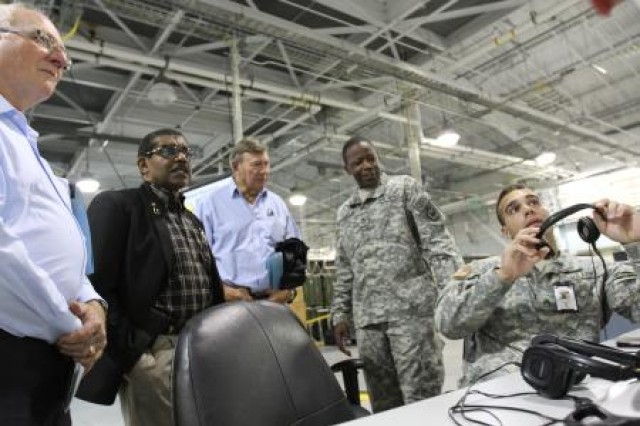 From right, U.S. Army Sgt. Derek Morvant and Sgt. 1st Class Travis Johnson, both assigned to 864th Engineer Battalion, 555th Engineer Brigade, explain the capabilities of a combat vehicle simulator to civilian aides to the secretary of the Army (CASAs) at Joint Base Lewis-McChord, Wash., June 24, 2014. The virtual training demonstration at the JBLM Mission Command Training Center was the last event of a three-day CASA conference. (Photo by U.S. Army Staff Sgt. Christopher Klutts, 20th Public Affairs Detachment)