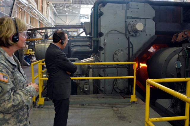 Mr. Gabriel Camarillo, the principal deputy at the Office of the Assistant Secretary of the Army for Acquisition, Logistics and Techology, observing the rotary forge operation.  Lt. Gen. Patricia McQuistion is to the left.